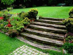a lot of flowers around the wooden garden steps Sloped Backyard Landscaping, Sloped Garden, Backyard Ideas, Landscaping Ideas, Garden Stairs, Terrace Garden, Garden Path, Back Gardens, Outdoor Gardens