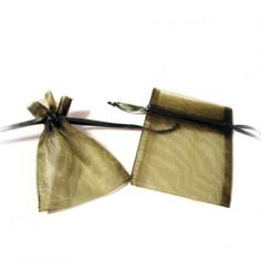 """Moss Green Organza Bags (Set of 10)   Nuptial Knick Knacks    Available is five popular sizes, our bags are made of high quality organza sheer, with a satin drawstrings. Our organza bags have a wide range of use for your bridal needs. They work great for bridesmaids' and guest gift packaging as well as candies and almonds. Choose from 5 different sizes:  3"""" x 4"""", 4"""" x 6"""", 5"""" x 7"""", 6"""" x 10"""" and 6.5"""" x 15""""(Perfect for wine and liquer bottles)"""