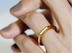 Very pretty ring. Plus I love that nail color