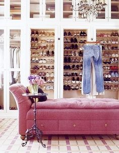 White closet, see trough doors, chandelier & pink chaise long