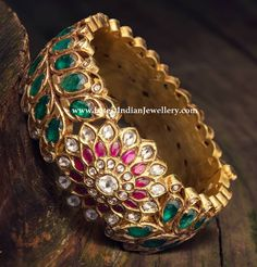 A timeless heritage gold kada bangle with screw opening, featuring a floral motif in the center. Stones like ruby, emerald, kundan and polki make this heavy broad bangle Antique Jewellery Designs, Fancy Jewellery, Indian Jewellery Design, Latest Jewellery, Jewelry Design, Gold Jewelry Simple, Trendy Jewelry, Fashion Jewelry, Indian Jewelry Sets