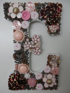 My colorful E with beads, rhinestones, jewelry