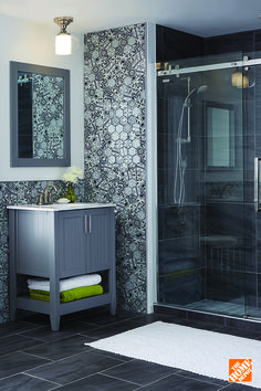 Porcelain tiles with a stone look give this bathroom an incredible, nature-inspired look.