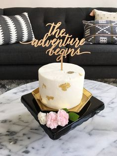 Let the adventure begin on a sweet note! This laser-cut wood cake topper is painted a muted gold for a modern look. Fun Wedding Cake Toppers, Cool Wedding Cakes, Wedding Cupcakes, Graduation Cake Toppers, Graduation Theme, Wedding Stuff, Wedding Ideas, Engagement Cake Design, Engagement Cakes