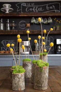 moss & craspedia in a log vase as seen on HGTV's Fixer Upper