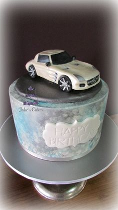 A handmade sugar Mercedes Benz SLS AMG GT for a lovely regular client of mine for her husband who really wants one of these supercars. For the side design I was inspired by the Mercedes car brochure it had lots of silver/blue and white clouds which I tried to recreate here