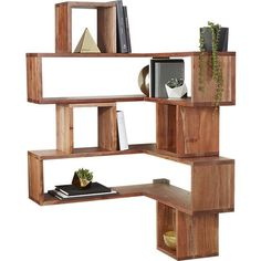 Shop corner block wood shelf.   Corners become attractive, usable space with this clever configuration of cubbies.  Solid acacia wood tower alternates small and large cubes/shelves creating tons of storage space.