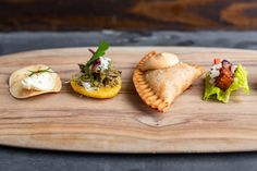 An hors d'oeuvres sampler featuring papadum, arepa with braised pork, empanada & Korean BBQ pork belly on lettuce. Sour Plum, Lunch Delivery, Greens Restaurant, Braised Pork, Korean Bbq, Hors D'oeuvres, Bbq Pork, Pork Belly, Empanadas