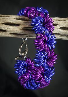 Purple Explosion Chainmaille Bracelet. Huh. This looks like you just take a central ring and loop a bunch of other rings through it. Am I right?