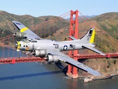 I've been trying to stick to photographs of these planes from the time they were in service, but seeing how this is such a beautiful plane with my favorite bridge in the background, I figured why not.