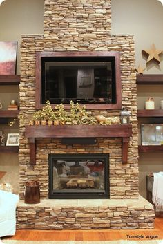 Love this mantle and how it's decorated. Perfect for our basement fireplace!