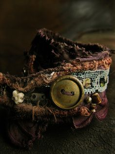 cuff~~ no real directions to make which is indicative to the gypsies style which this cuff is patterned after. These cuffs have bits of mementos found along their journey...
