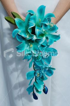 Shop Jade Galaxy Blue Orchid Stargazer Lily Small Bridal Bouquet online from Silk Blooms at just £ It is an online artificial wedding flowers store in UK. Teal Wedding Bouquet, Teal Wedding Flowers, Small Bridal Bouquets, Teal Flowers, Blue Orchids, Bride Bouquets, Bridal Flowers, Wedding Colors, Turquoise Weddings