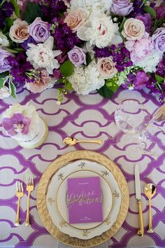 Punchy patterned purple tablescape with gold accents