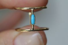 mociun 14K yellow gold with oblong turquoise stone