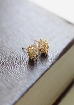 gold thread around a pearl! someone please get me these. or show them to Tyler.
