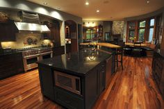 Gorgeous wood floor, marble counters tops, and stainless steel appliances. Dream kitchen.