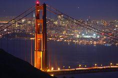 Marin County & the Bay Area, San Francisco image gallery - Waves crashing on rocks at Marshall's Beach beside Golden Gate Bridge.