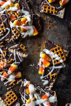 Halloween Bark - maybe switch the matzo crackers for graham and use those new S'Mores candy corn. YUM!