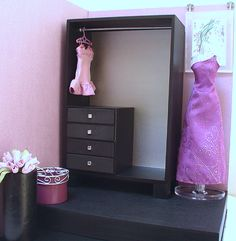 diy barbie closet. Jewelry in the chest of drawers and Barbies as decor