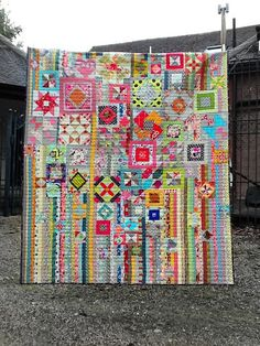 You know how there are always some odd blocks hanging around the sewing room... ones of different sizes and colors? Well! I think I could do something like this with those... such a modern looking quilt and really scrappy :)
