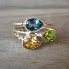 If I could replace the peridot with an amethyst I would have the most kick ass mother's ring ever.