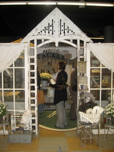 Great use of architectural salvage to create an entrance to an antique booth ~ Ms. Mac's Antiques @ Junk Bonanza....display