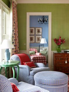 A happy combination of colors & fabrics. So cheerful & fun! Nice round ottoman too.The aqua table does clash with the yellow green walls though.