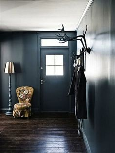 dark wood + black entryway. the #floral chair is perfect. via design is mine blog