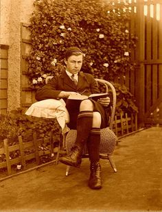 Teenage boy reading a book in the garden, 1910-1920 by State Library of Queensland, Australia, via Flickr