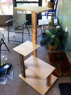 Make a multi level cat tree using scrap wood and carpet.