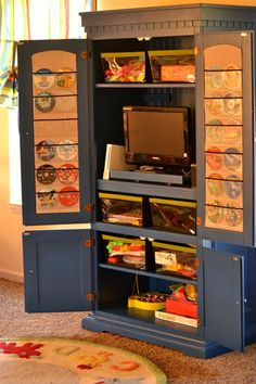 Toy cabinet for kids room- Candyce has this EXACT piece of furniture. thinking i'm going to try and be adventurous with it Eames, Armoire For Sale, Craft Cabinet, Cabinet Storage, Cabinet Organizers, Cabinet Ideas, Game Storage, Storage Ideas, Movie Storage