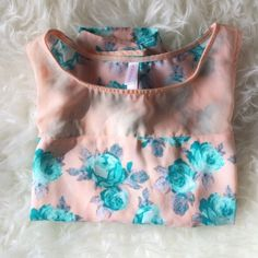 ✨HP✨ Sheer Peach and Teal Floral Crop Top Sheer peach and teal floral crop top. Never been worn, no snags or wear and tear. Listing includes only the crop top, all other items are only being used for display. Host Pick | Weekend Wardrobe | 02-28-16 Xhilaration Tops Crop Tops