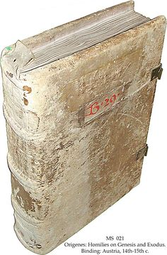"""Binding: Austria, Lambach Abbey, 14th-15th c., white tawed leather over wooden boards sewn on 3 thongs, original tab at the top of the spine, 2 clasps, medieval title-label and shelfmark """"B 29"""". Manuscript in Latin on vellum, Wilhering, Austria, 2nd half of 12th c., 126 ff. (complete) - Origenes: Homilies on Genesis and Exodus. Translated by Rufinus."""
