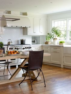 Lindy Weaver Design Associates: Fantastic kitchen with ivory cabinets and marble countertop with mini subway tile . Ivory Kitchen Cabinets, Wood Floor Kitchen, Shaker Cabinets, Kitchen Flooring, Kitchen Countertops, Marble Countertops, White Cupboards, Kitchen Chairs, Reclaimed Wood Kitchen