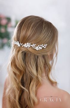 The price is for one hairpin. There are 3 pins (2 to the right + 1 to the left) in the photo of the model. TopGracia shop: http://www.etsy.com/shop/TopGracia/ Welcome to my social network :) https://www.facebook.com/Wedding-hair-accessories-825284300897738/