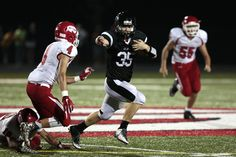 Gilbert's Cody Dvorak rushes up field past the Boone defense on Friday. Photo by Brian Achenbach/Special to the Tribune   http://amestrib.com/sports/prep-football-gilbert-holds-top-boone
