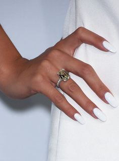 Three different ways to wear white nail polish in the summer. http://r29.co/2swGqPY