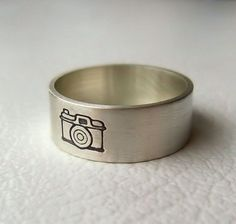 Hubby and I are looking for new wedding bands...this would be very fitting for us.