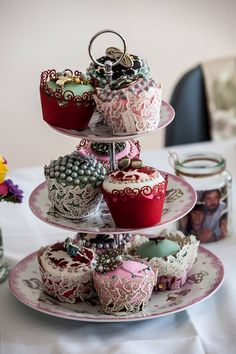 Decorated cup cakes from a high tea wedding. // photo by Steven Lloyd Photography