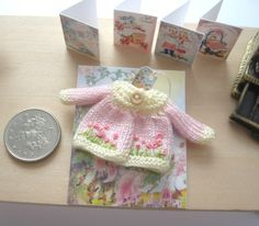 dollhouse knitted baby doll matinee jacket hand embroidered 12th scale miniature by Rainbowminiatures on Etsy