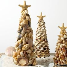 DIY Shell tree.  Beautiful!  Can also use these as centerpieces for luau/beach parties, just leave the star off the top.