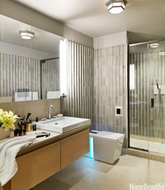 In the master bath of a Andy Warhol-inspired apartment, designed by Groves, Veranda Bamboo tiles by Ann Sacks are reminiscent of a fluted column and add texture to the natural palette.