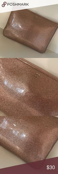 """Kate Spade pink glitter clutch Gorgeous Kate Spade Rose gold glitter clutch. Perfect for making a simple and dainty statement. 10""""L x 7.5""""H. Gently used, with a slight discoloration on the side as pictured. Other than that, it's in phenomenal condition and ready for a new home. 💓 kate spade Bags Clutches & Wristlets"""
