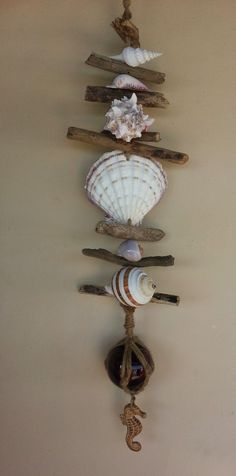 Seashell Mobile with Glass Fishing Floats, Each one is a handcrafted piece of art.  Our Fishing Floats come in Reds, Dark blue, aqua and seaglass blue, we use abalone shells, scallop shells and many other all natural seashells.