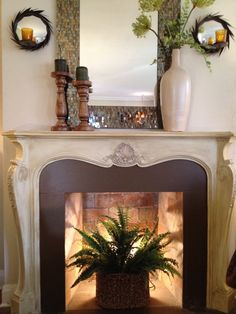 Fireplace decoration idea love the candle sconces too