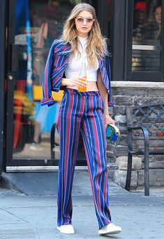 A printed suit can be a hard look to pull off, but obviously Gigi can handle it. She makes this boxy, 60s striped one look so chill by wearing the jacket on her shoulders and adding some crisp-white kicks