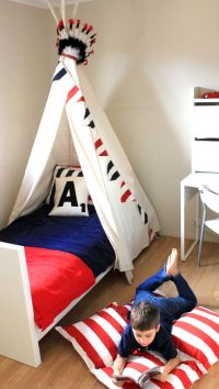 LOVE the little bit of privacy and LOTS of charm this teepee bed provides. A great idea in a shared bedroom!
