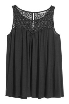 H&M+ Top with a lace yoke: Sleeveless A-line top in soft jersey with a lace yoke and an opening with a button at the back of the neck.