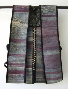 saki ori: recycled fiber | cotton reinforced with hemp stitching | sashiko stitching on shoulder adds strength; indigo + red fiber appear purple | Japan | Taisho Period: c. 1912-'25 | type of vest traditionally used in the mountains for cutting and carrying wood to make charcoal for household use